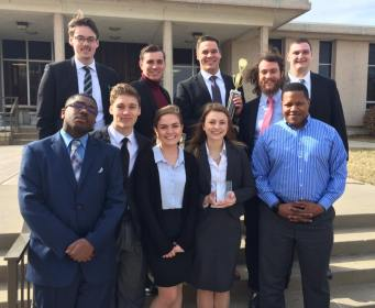 2017 Regional team in Topeka with 5th place team trophy and Madalyn Wurst all-regional attorney award