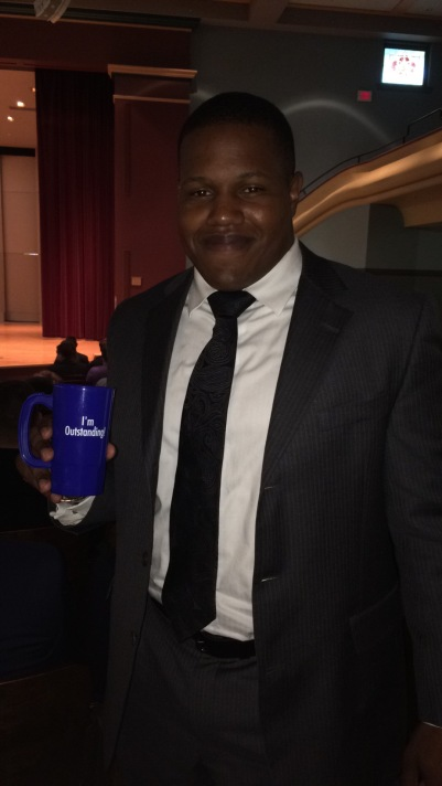 Benjamin Boyd with award, fall 2016 at Drake